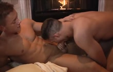 Two hot gay guys fucking by the fireplace