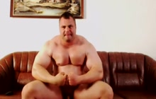 Amateur muscled guy strokes cock