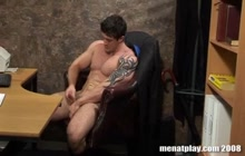 Sexy dude working out and masturbating in the office