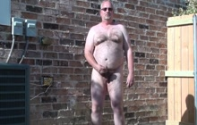 Horny bear stroking his dick outdoors