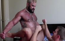 Big muscled bear fucks younger guy