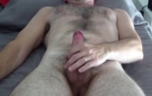 Horny dude masturbating till he cums on his belly