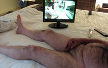 Cumming while watching porn in bed