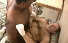 White daddy rides black cock